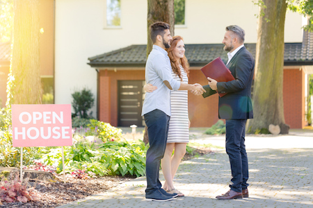 Real estate agent welcoming visitors